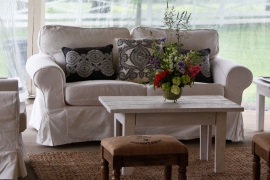 White Upholstered Love Seat
